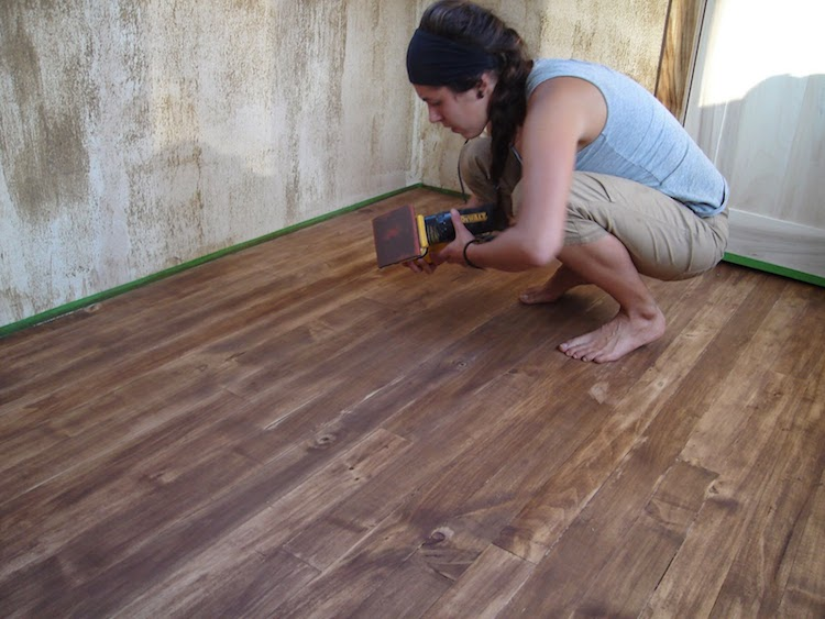 Corinne working on the floor during construction