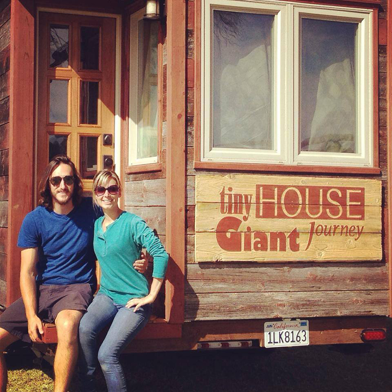 Guillaume and Jenna in front of their tiny house