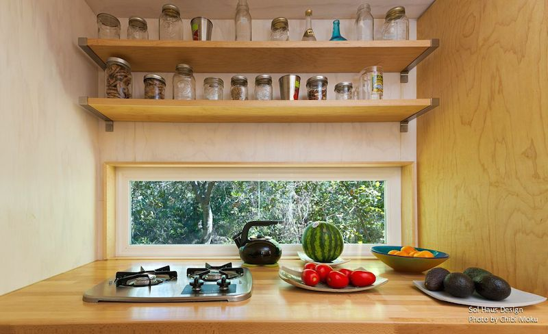 Kitchen with small rectangular window and solid shelving