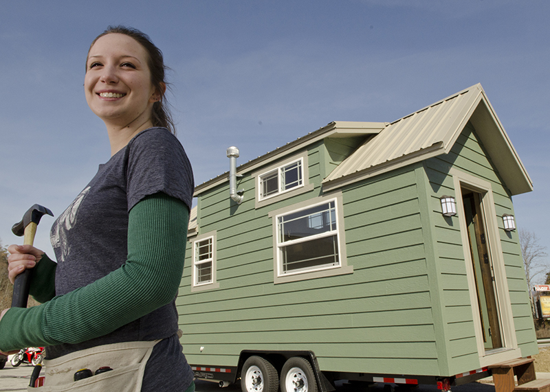Sarah Myers next to her tiny home on wheels