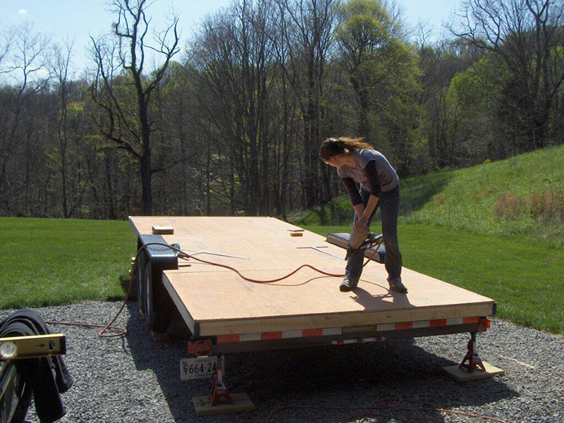 Sarah working on the foundation of her home - a trailer