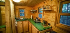 Tiny House Couple Escapes to the Mountains to Build 120 Sq Ft Home. I Love the Green Countertops.