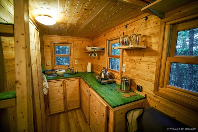 The green countertops work well with the natural wood