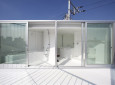 Impressively Modern Tiny Home in Japan. I Love the White Spiral Staircase.