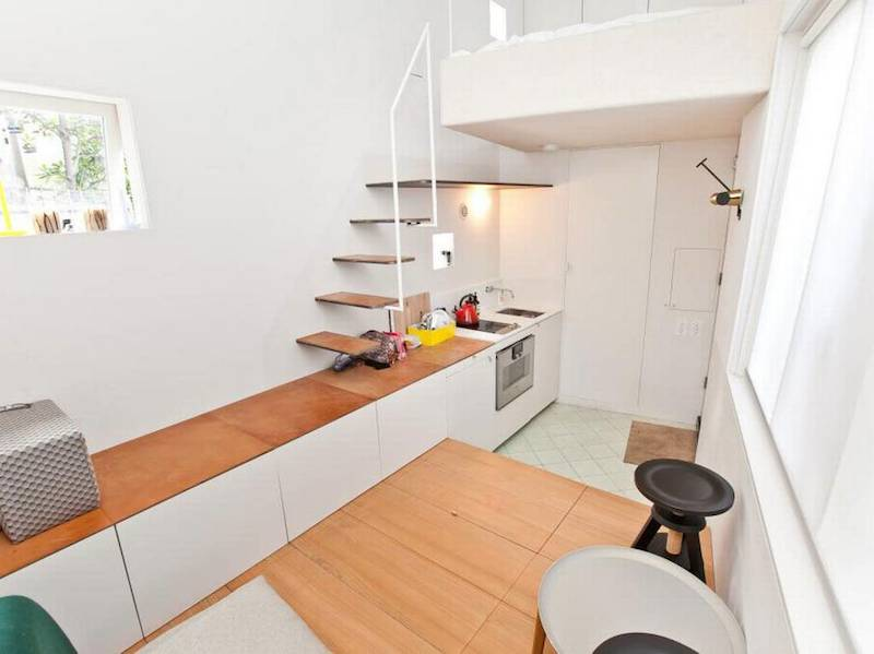 The stairway mounts directly to the wall, and starts on the kitchen countertop