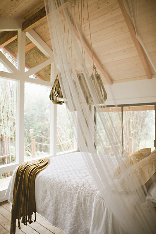 There's an open and airy feel to her tiny home's loft
