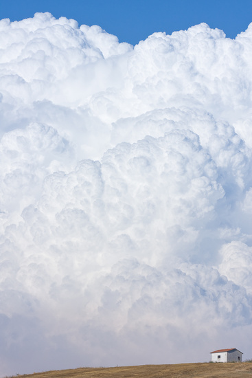 clouds and a tiny house