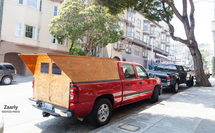 Back of a custom wooden truck camper