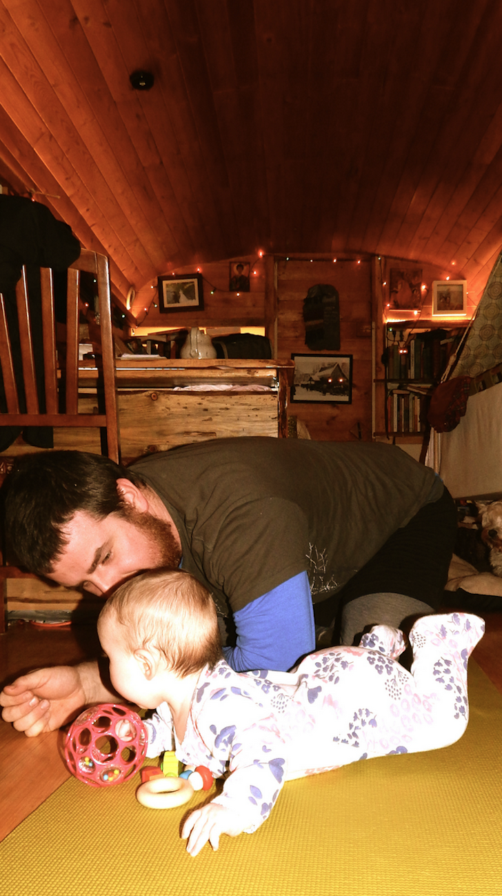 Playing with baby in tiny house
