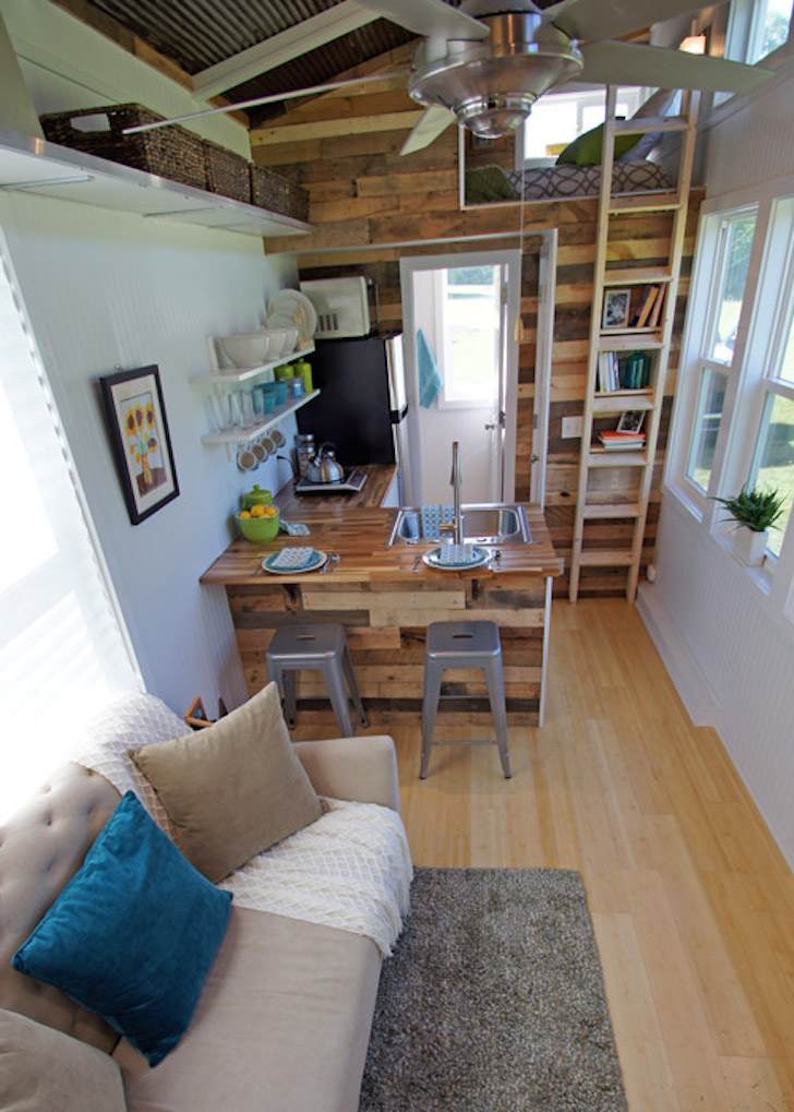 Brightly colored tiny house on wheels called the yosemite for Tiny house interieur