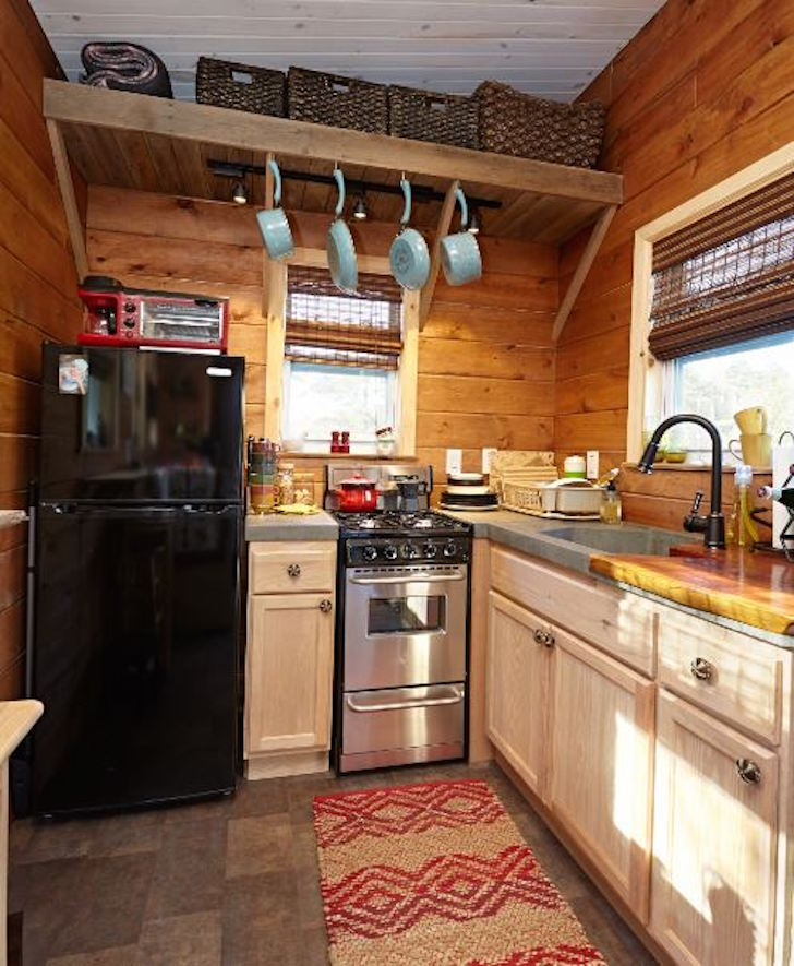 Wood paneled tiny house built on a gooseneck trailer for Small house plans with big kitchens