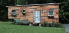 Wood-Paneled Tiny House Built On A Gooseneck Trailer Provides 276 Square Feet Of Living Space
